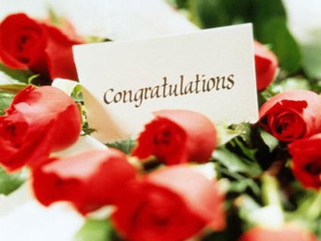 conbgratulazioni fiori foto