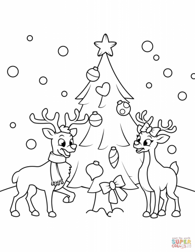 Renne vicino all'albero di Natale