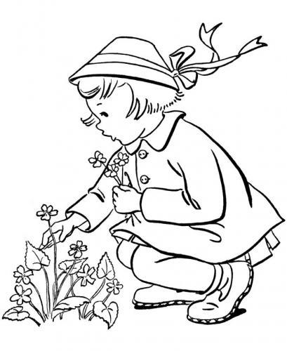 bambina che raccoglie i fiori